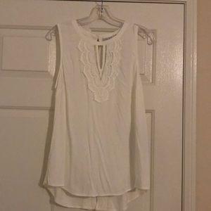 New sleeveless white blouse